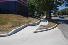 Modified perpendicular ramp with depressed sidewalk and Type 'A' curbing to minimize grading